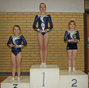 Winning membes of Brentwood Trampoline Club take a 1-2-3